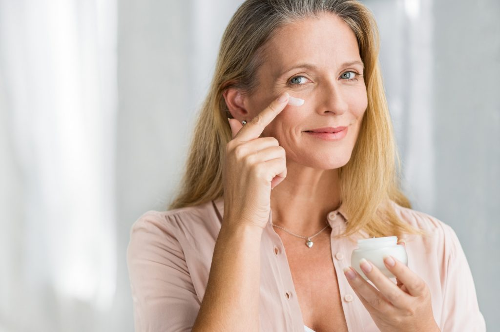 woman with anti-ageing cream