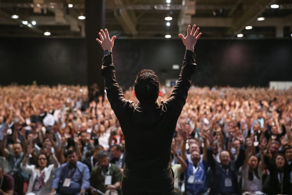 motivational speaker in front of crowd