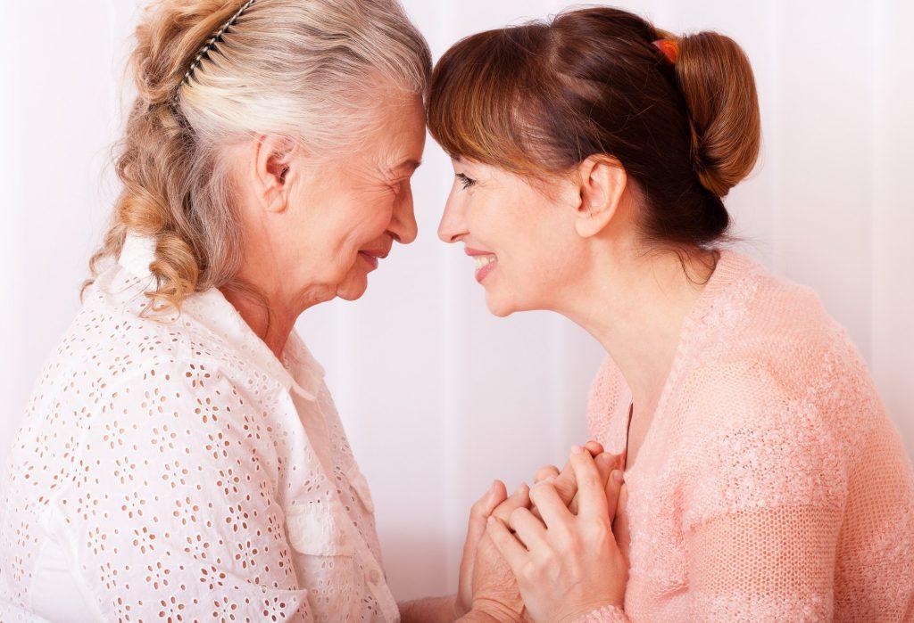 senior and her caregiver