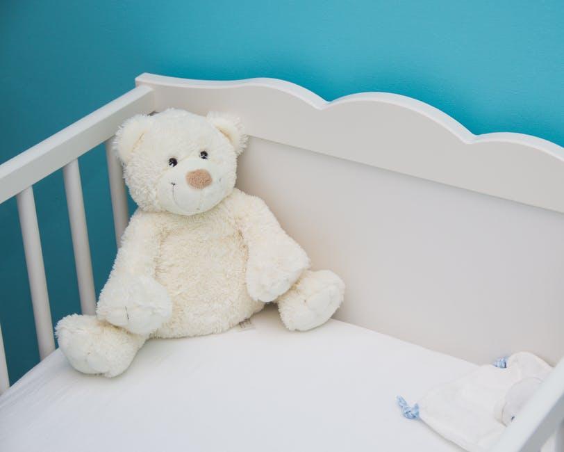 crib with teddy bear