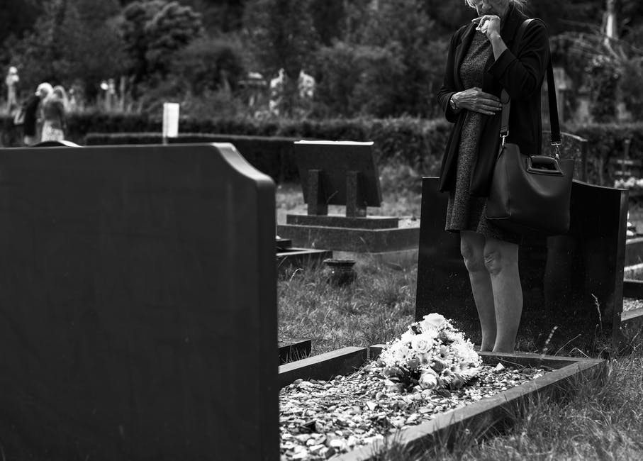woman at grave of loved one