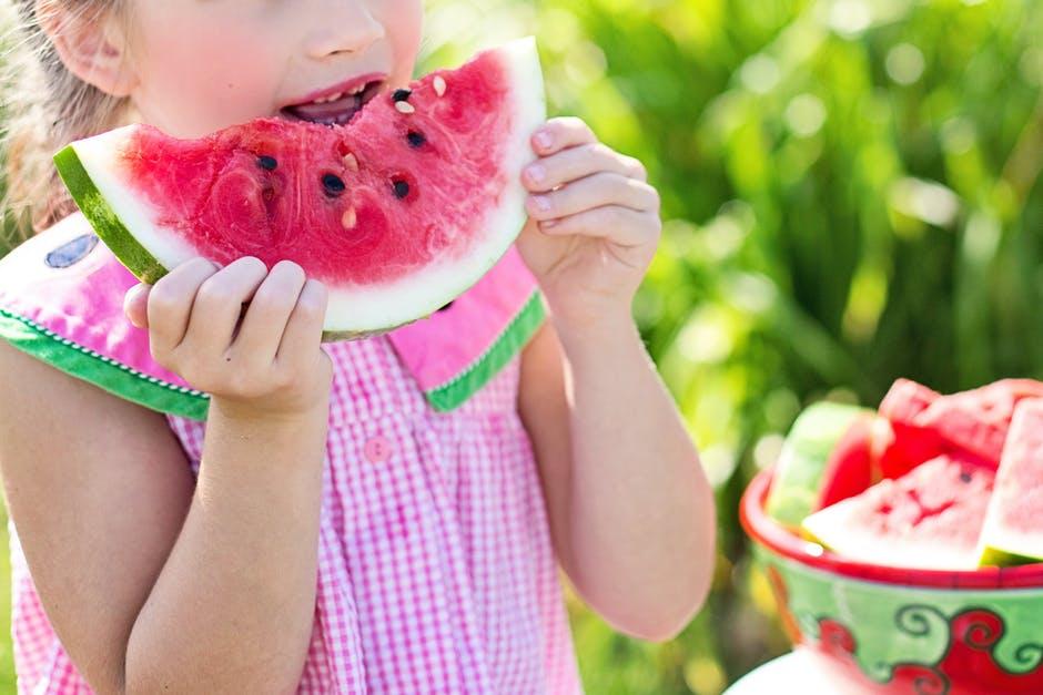 child eating watermellon