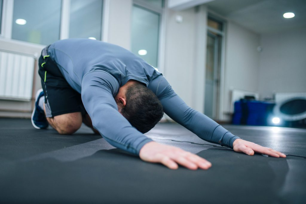 man doing back stretches