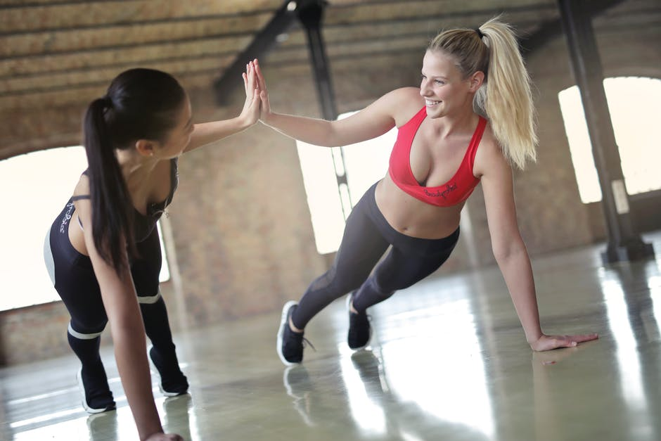 two fit women high fiving